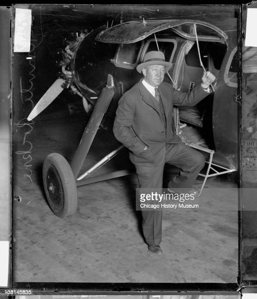 University of Notre Dame football coach Knute Rockne standing by a Lockheed Vega monoplane in a hangar Chicago Illinois 1925