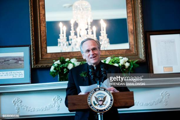 University of Notre Dame President John I. Jenkins says a prayer during a Saint Patrick's Day breakfast at the Naval Observatory on March 16, 2017 in...