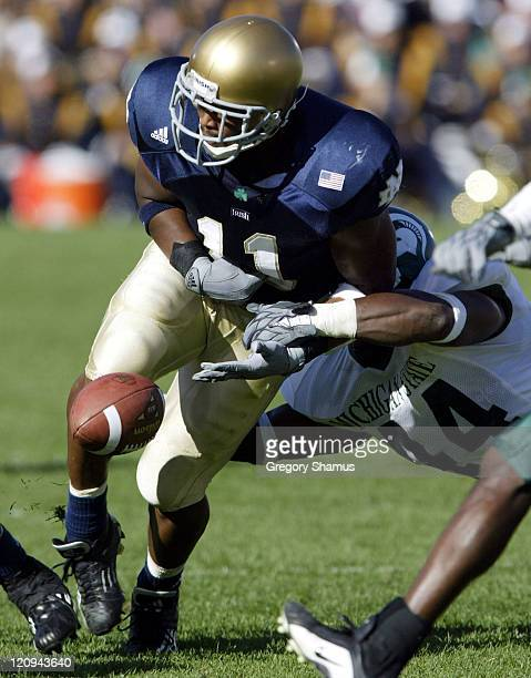 University of Notre Dame RB Marcus Wilson fumbles the ball after a hit from Michigan State LB Ronald Stanley during 3rd quarter action at Notre Dame...