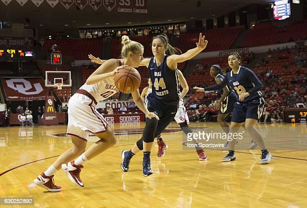 University of Oklahoma player Peyton Little dribbles the ball past Oral Roberts University player Maria Martianez during the Oral Roberts University...