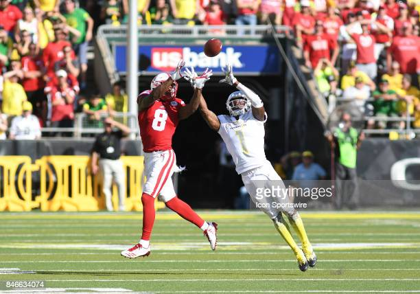 University of Oregon CB Arrion Springs attempts to intercept a pass intended for University of Nebraska WR Stanley Morgan Jr during a college...