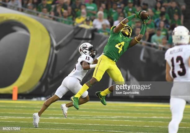 University of Oregon CB Thomas Graham Jr goes high to intercept a pass intended for Southern Utah WR Isaiah DiegoWilliams during an NCAA football...