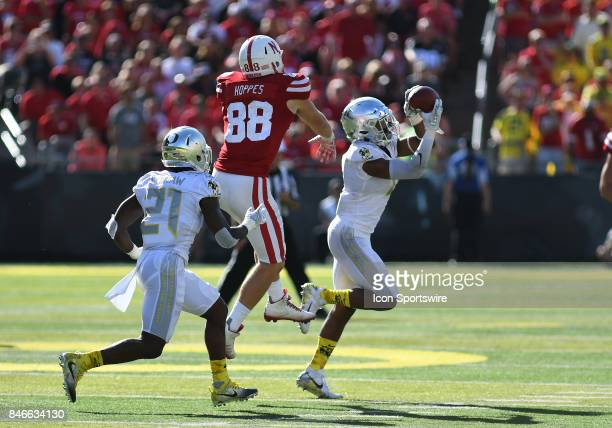 University of Oregon CB Thomas Graham Jr intercepts a pass intended for University of Nebraska TE Tyler Hoppes during a college football game between...