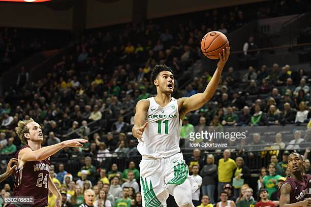 University of Oregon freshman forward Keith Smith goes in for a layup during a nonconference NCAA basketball game between the University of Montana...