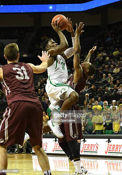 University of Oregon guard Dylan Ennis puts up a shot in the lane during a nonconference NCAA basketball game between the University of Montana...