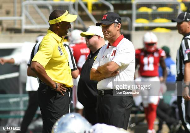 University of Oregon head coach Willie Taggart and University of Nebraska head coach Mike Riley talk on the field prior to the start of the game...