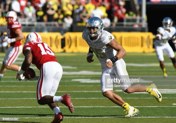 University of Oregon ILB Troy Dye pursues University of Nebraska WR De'Mornay PiersonEl during a college football game between the Nebraska...