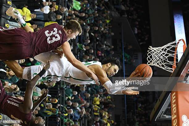 University of Oregon junior forward Dillon Brooks goes in for a layup over University of Montana redshirtfreshman Jared Samuelson during a...