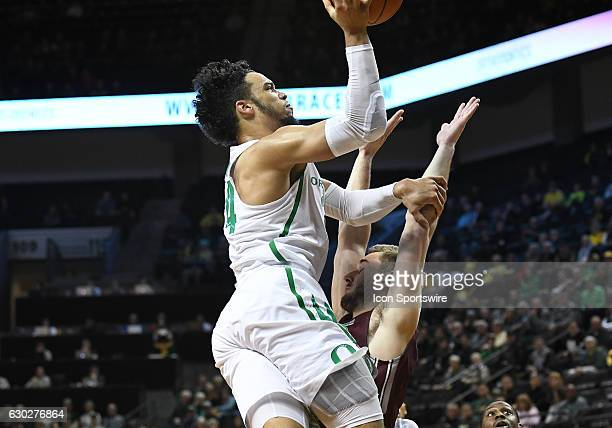 University of Oregon junior forward Dillon Brooks shoots over University of Montana senior forward Jack Lopez during a nonconference NCAA basketball...