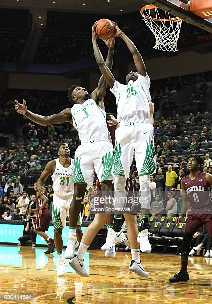 University of Oregon junior forward Jordan Bell and University of Oregon senior forward Chris Boucher both fight for the same rebound during a...