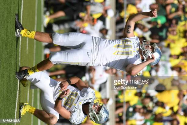 University of Oregon K Aidan Schneider watches after an extra point attempt from the hold of University of Oregon QB Taylor Alie during a college...