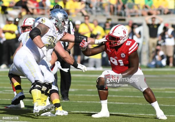 University of Oregon OL Calvin Throckmorton blocks against he rush by University of Nebraska DL Freedom Akinmoladun during a college football game...
