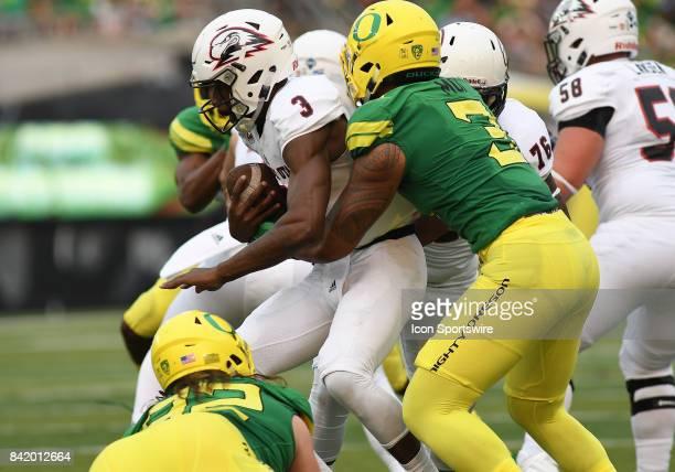 University of Oregon OLB Jonah Moi tackles Southern Utah QB Patrick Tyler for a loss during an NCAA football game between the Southern Utah...