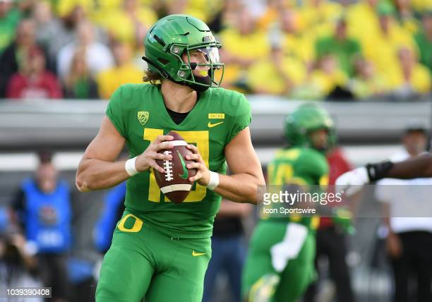 University of Oregon QB Justin Herbert rolls out to pass during a college football game between the Oregon Ducks and Stanford Cardinal on September...