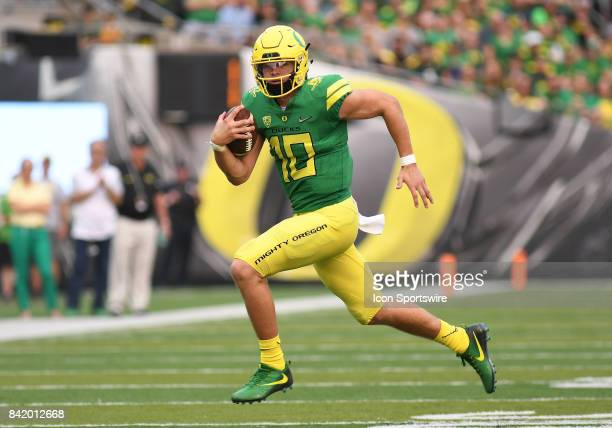 University of Oregon QB Justin Herbert rushes for positive yardage during an NCAA football game between the Southern Utah Thunderbirds and Oregon...