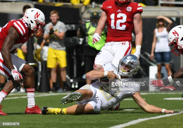University of Oregon QB Justin Herbert slides after a run during a college football game between the Nebraska Cornhuskers and Oregon Ducks on...