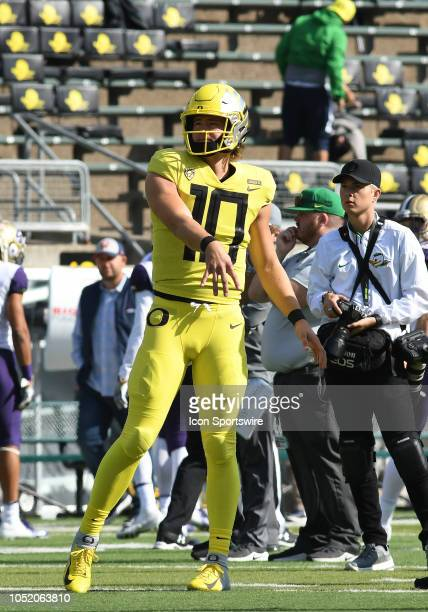 University of Oregon QB Justin Herbert warms up on the field prior to the start of the game during a college football game between the Oregon Ducks...