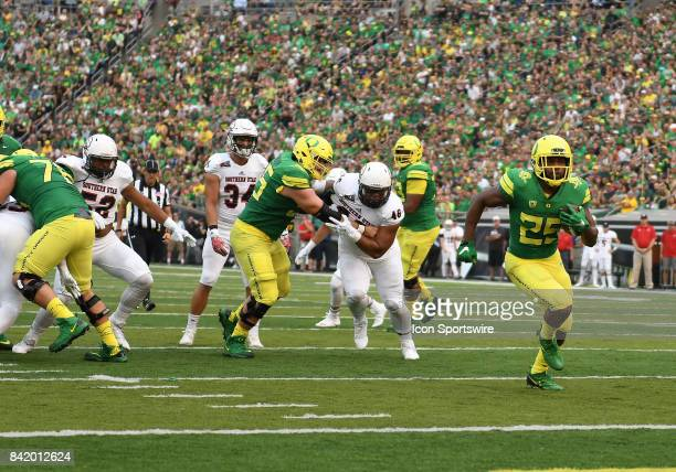 University of Oregon RB Kani Benoit runs for a touchdown in the first quarter that put the Ducks up 217 during an NCAA football game between the...