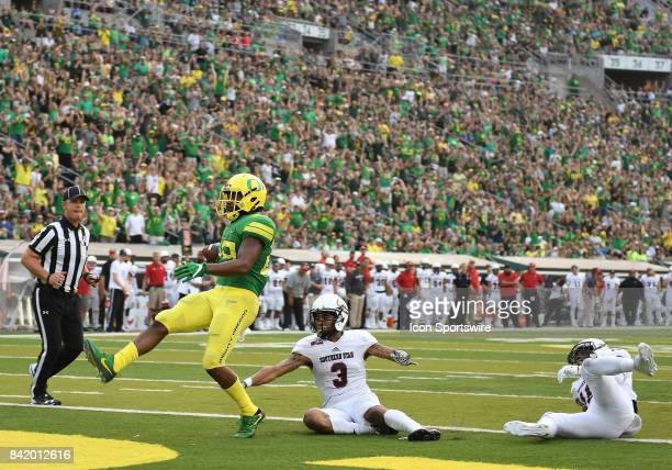 University of Oregon RB Kani Benoit scores on a 29yard run in the second quarter to put the Ducks up 357 during an NCAA football game between the...