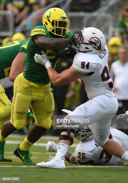 University of Oregon RB Royce Freeman gives a stiffarm to Southern Utah LB Taylor Nelson during an NCAA football game between the Southern Utah...