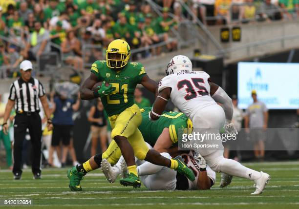 University of Oregon RB Royce Freeman runs for positive yardage while defended by Southern Utah LB Chinedu Ahanonu during an NCAA football game...