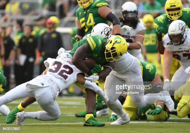 University of Oregon RB Royce Freeman runs through the tackle of Southern Utah S Alan Holsten for a gain during an NCAA football game between the...
