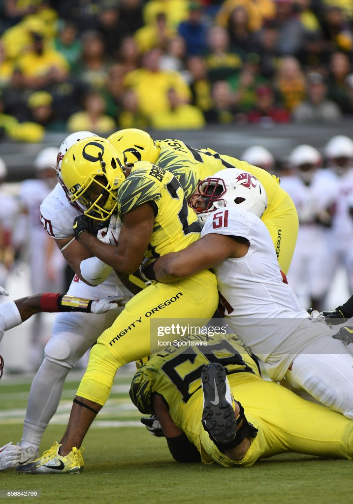 University of Oregon RB Tony Brooks-James (20) is stopped by Washington State LB Frankie Luvu (51) after a gain during a college football game between the Washington State Cougars and Oregon Ducks on October 7, 2017, at Autzen Stadium in Eugene, OR.