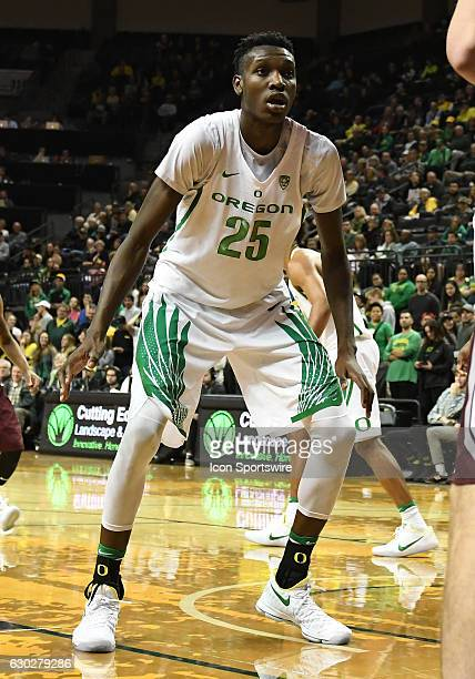 University of Oregon senior forward Chris Boucher readies to defend an inbound pass during a nonconference NCAA basketball game between the...