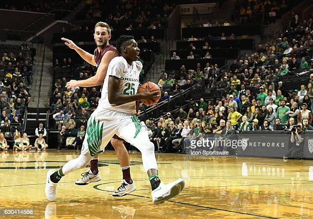 University of Oregon senior forward Chris Boucher readies to shoot during a nonconference NCAA basketball game between the University of Montana...