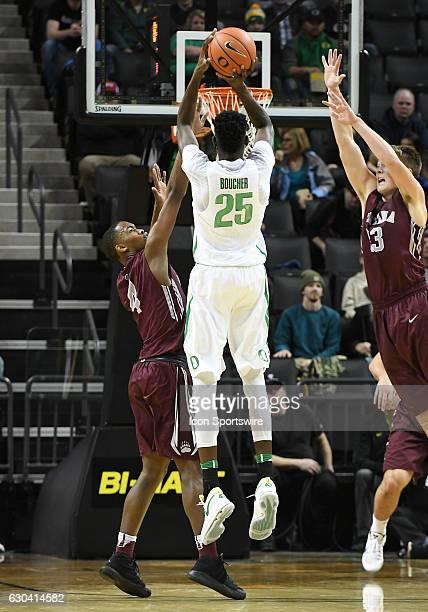 University of Oregon senior forward Chris Boucher shoots over University of Montana freshman guard Sayeed Pridgett and University of Montana...