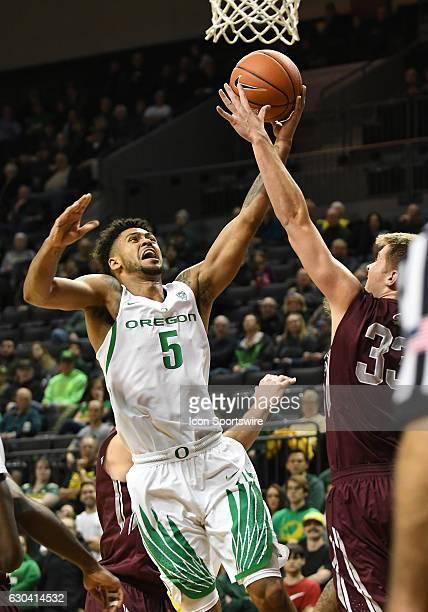 University of Oregon sophomore guard Tyler Dorsey has his shot blocked by University of Montana redshirtfreshman Jared Samuelson during a...