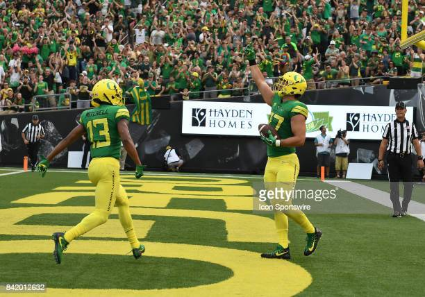 University of Oregon TE Jacob Breeland reacts to catching a 20yard touchdown pass to put the Ducks up 147 during an NCAA football game between the...