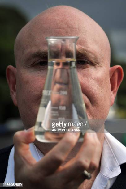 University of Otago geneticist, Professor Neil Gemmell poses with a beaker of water on the shores of Loch Ness after announcing the results of...