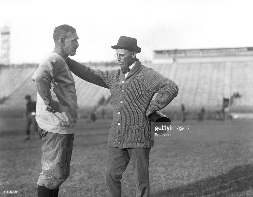 F. Harold Gaston Conversing with John Heisman : News Photo