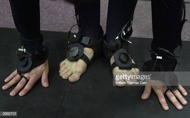 University of Pennsylvania student Aaron Bloomfield's hands and feet are seen while he stretches in preparation to demonstrate the LiveActor stereo...