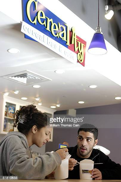 University of Pennsylvania students Jillian Mariutti and Andrew Erace have a bowl of cereal at Cereality Cereal Bar and Cafe December 1 2004 in...