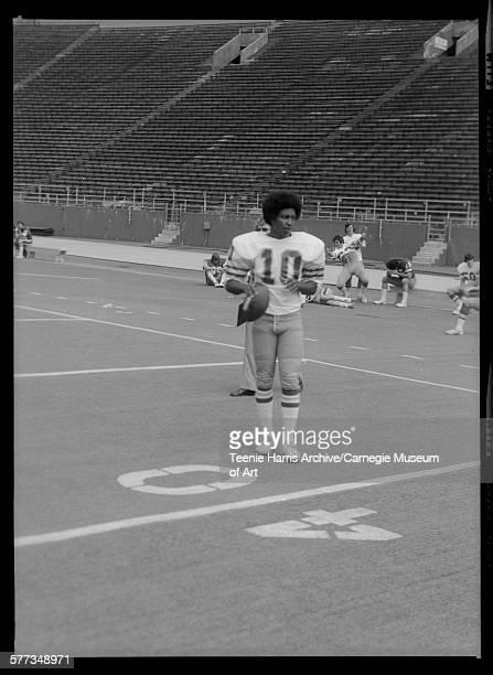 University of Pittsburgh football player no 10 Robert Haygood holding football at forty yard line at Pitt Stadium Pittsburgh Pennsylvania November...