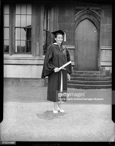 University of Pittsburgh graduate Helen Elizabeth Smith posed with diploma in front of Cathedral of Learning Oakland Pittsburgh Pennsylvania June 1946