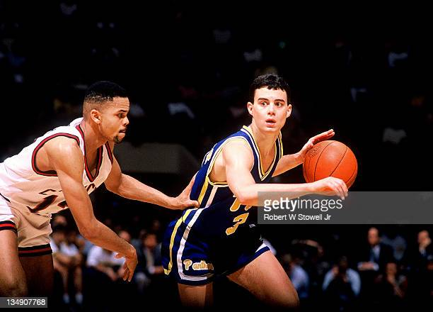 University of Pittsburgh's Sean Miller against the University of Connecticut's Chris Smith Hartford CT 1990