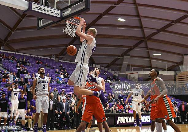 University of Portland freshman forward/center Joseph Smoyer slams home the shot that put the game into overtime during a nonconference NCAA...