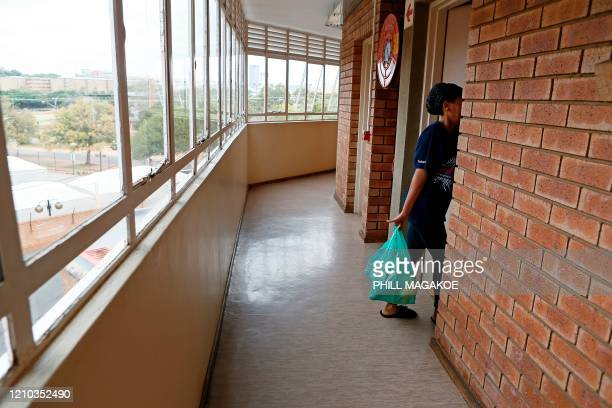 University of Pretoria international student from Botswana enters her room at their place of residence and carry food parcels donated by Kindness...