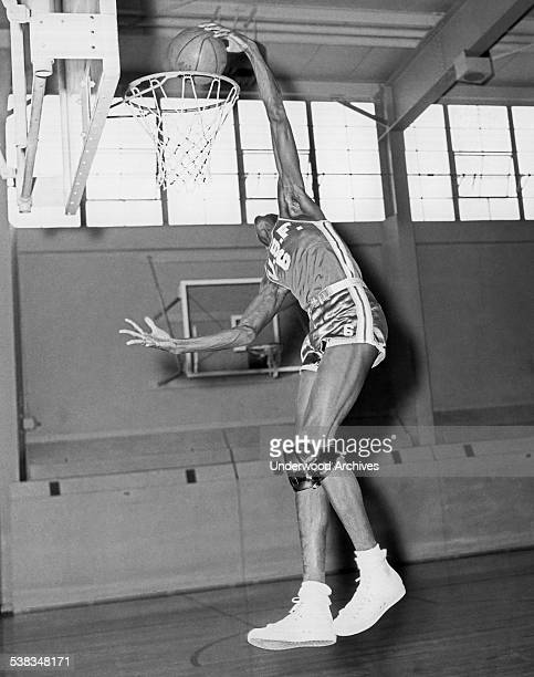 University of San Francisco basketball player Bill Russell showing the form he will bring to the pros when he joins the Boston Celtics San Francisco...