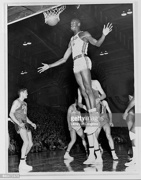 University of San Francisco Dons player Bill Russell sinks a basket during the semifinals of the NCAA basketball tournament in Chicago Illinois