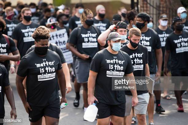 University of South Carolina offensive lineman Vincent Murphy joins teammates and other student athletes on campus during a demonstration against...