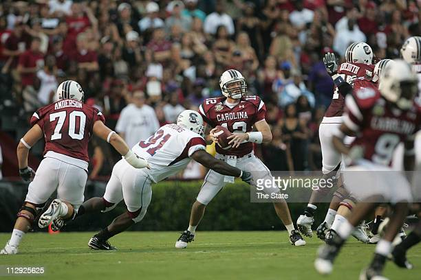 University of South Carolina quarterback Blake Mitchell is sacked by South Carolina State University's James Simmons during the first quarter...