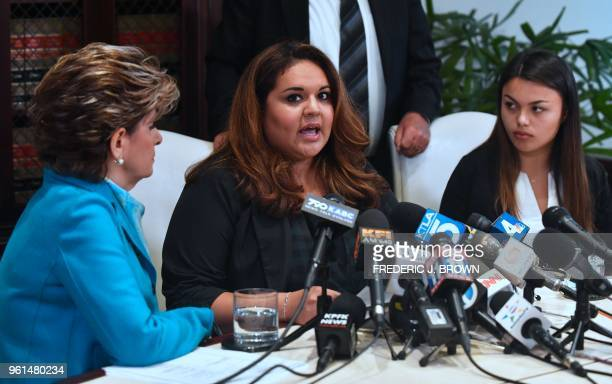 University of Southern California student Angela Esquivel Hawkins speaks while flanked by attorney Gloria Allred and current USC student Daniella...