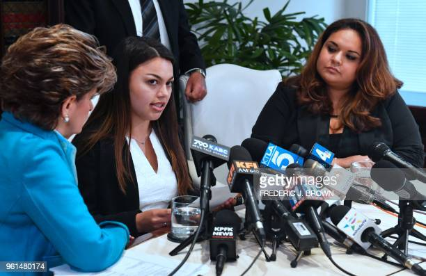 University of Southern California student Daniella Mohazab while flanked by attorney Gloria Allred and former USC student Angela Esquivel Hawkinns...