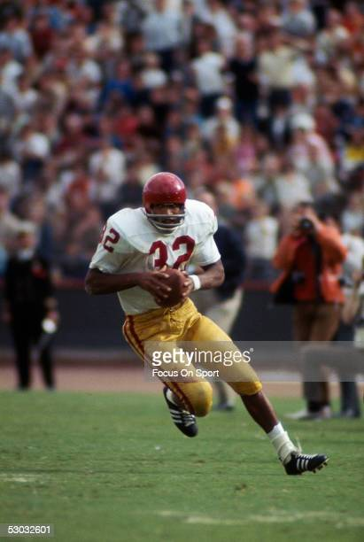 University of Southern California Trojans' running back O.J. Simpson runs with the ball during a game.