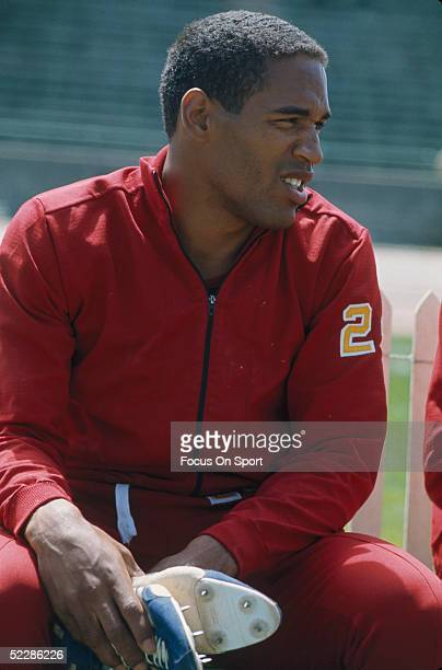 University of Southern California's running back OJ Simpson sits as he puts on his shoes at the track of USC in 1968 in Los Angeles California