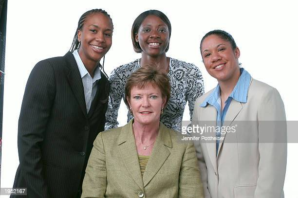 University of Tennessee players Tamika Catchings and Gwen Jackson of the Indiana Fever and Kara Lawson of the Detroit Shock pose with Coach Pat...
